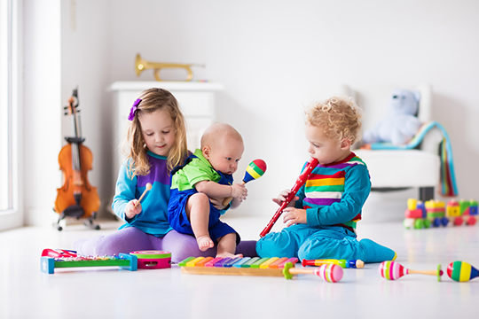 Encourage younger children with musical toys and instruments that let them explore on their own.